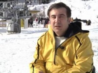 Why does Saakashvili strain relations with Russia?
